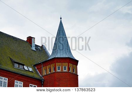 part of large catherdral and cloudy sky in stralsund germany