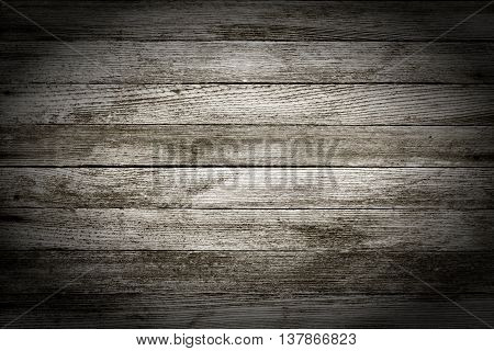 background texture of old gray wooden barn boards with vignette. black and white photo