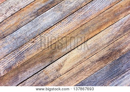 background texture old gray barn board with diagonal wooden slats