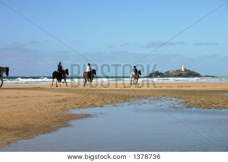 Riding Horses On Gwithian Sands Towards Godrevy