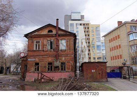 Nizhny Novgorod Russia. - April 22.2016. Residential old brick two-storey house pimped on a background of a modern residential complex on the street Sergievskaya 23