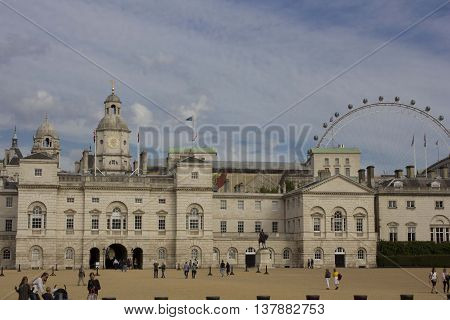 LONDON, UNITED KINGDOM - SEPTEMBER 11 2015: Horse Guard's Palace in London with the Millennium Wheel in the background.