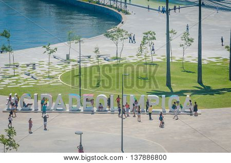 Rio de Janeiro Brasil - March 06 2016: Sign Letters Olympic City in front of the Museu do Amanhã and VLT Carioca - Light vehicle on rails stands in Maua Plaza in the regenerated Porto Maravilha area.
