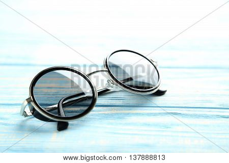 Black Sunglasses On A Blue Wooden Table