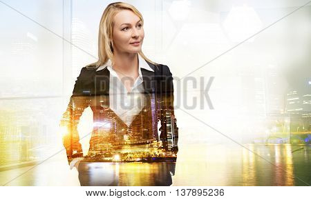 Thoughtful businesswoman on illuminated night Singapore city background with copy space. Double exposure