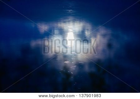 moon reflecting in misty water surface. Silence concept.