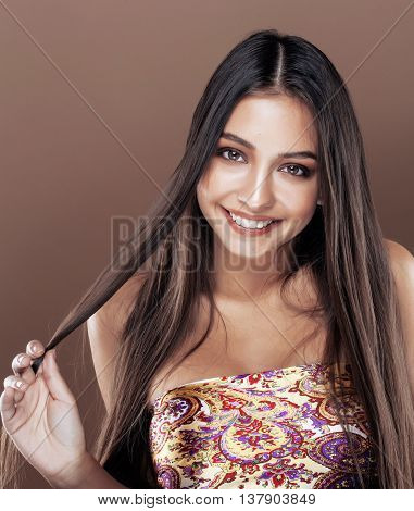 cute happy young indian woman in studio close up smiling, fashion mulatto flirting