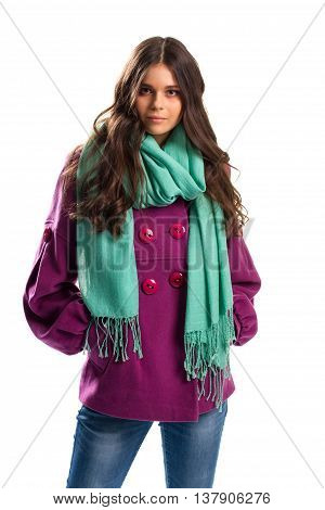 Woman in short purple coat. Turquoise scarf with fringe. Fleece outerwear of best quality. New clothes in autumn lookbook.