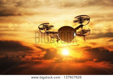 Drone flying at sunset. Sun shining on dramatic sky. 3D rendering