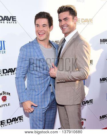 LOS ANGELES - JUN 29:  Adam Devine & Zac Efron arrives to the