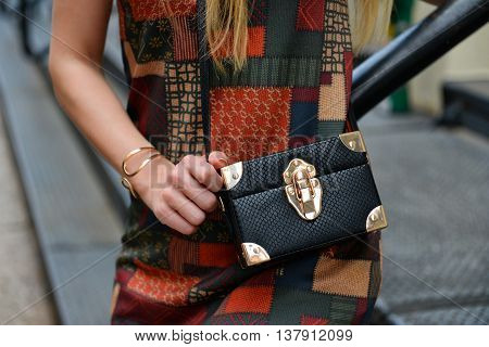 Black leather clutch bag and dress. Slylish women`s summer 2016 outfit.