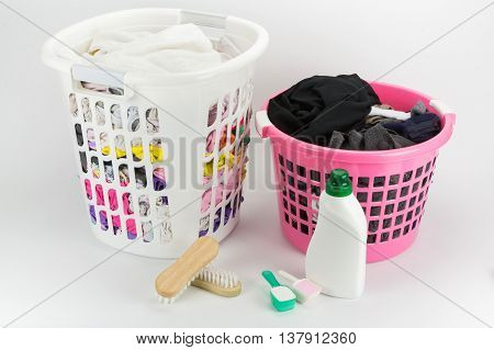 Basket Of Different Clothes Waiting For Wash With Washing Powder, Fabric Softener And Clothes Brush