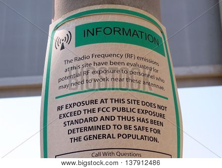 Warning sign: radio frequency antennae information outdoors.
