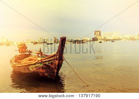 Selling an old rowboat tied to the sea Pattaya Chonburi Thailand.