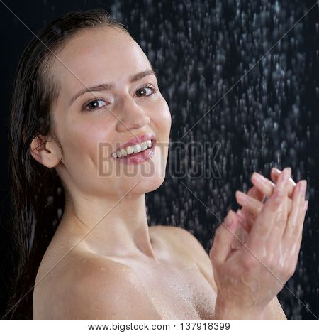 A Woman Standing At The Shower