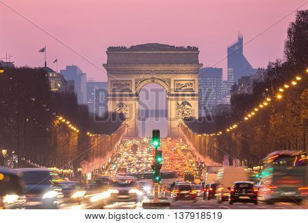 Paris Arc of Triomphe along Champs-Elysees France sunset poster