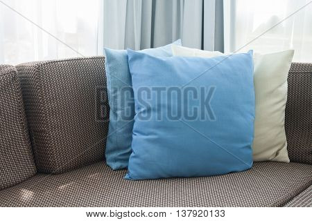 Sofa With Pillows In Room