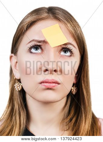 Confused woman with a sticker on her forehead isolted on white
