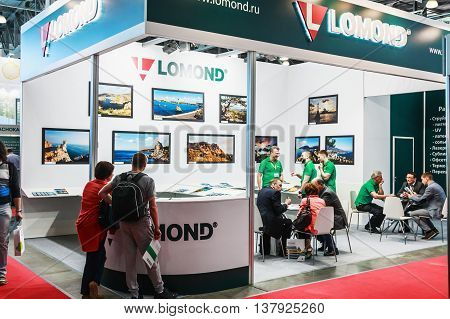 RUSSIA MOSCOW - June 14 2016: Visitors and exhibitors visiting the stands and exhibits at the exhibition