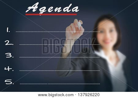 Agenda Woman writing word, concept, management, analysis