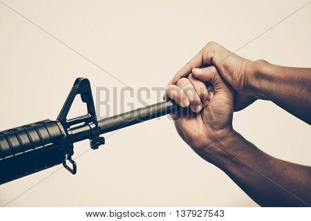 Hands stopping gun violence / gun control law