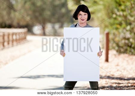 Male to Female Transgender holding large posterboard blank sign