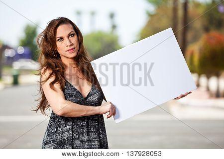 Male to female Transgender holding blank sign
