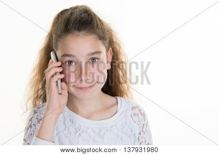 Smiling Young Girl Talking On The Phone Isolated