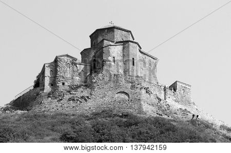 Jvari is a Georgian Orthodox monastery of the 6th century near Mtskheta - most famous symbol of georgiam christianity. Photo in black and white color style.