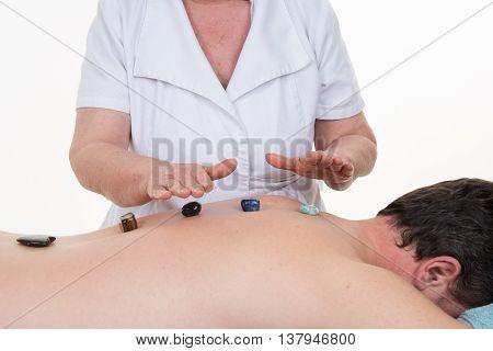 Man Having A Stone Massage In A Spa Salon ( Crystal )