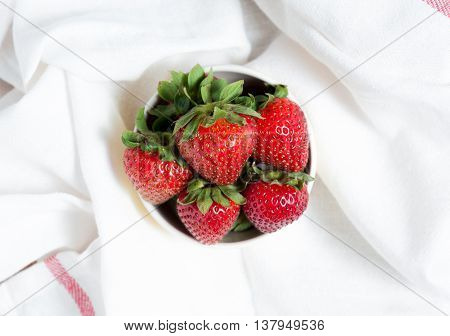 Fresh Strawberry And Juice On White Fabric. Flat Lay.