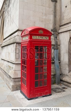 traditional red phoone box in the streets of London