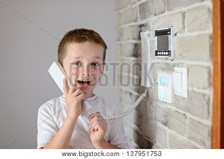 Little Baby Boy Talking On Intercom