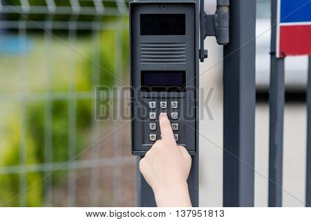 Little Child Boy Pushes A Button On The Intercom