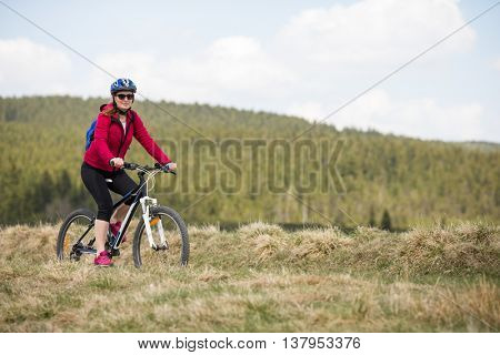 Middle aged woman riding bike