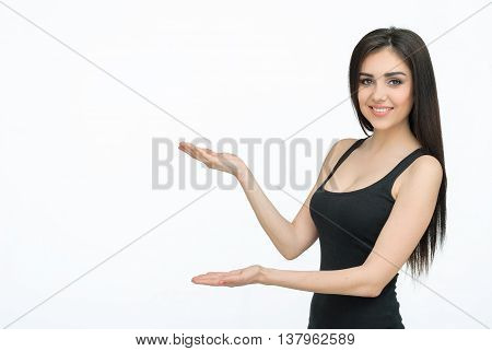 Woman showing something with open hand palm smiling joyful and happy. Caucasian female girl presenting something isolated on white background. Copyspase for product or sign text