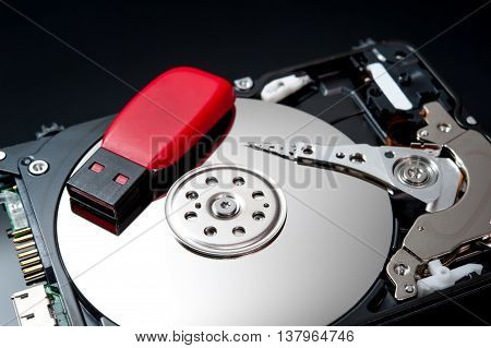 USB Flash Drive on hard disk drive close up