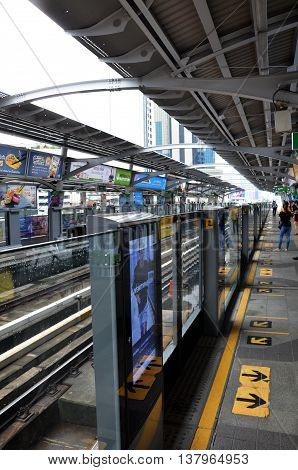 Traveller Waits For Bts Skytrain  In Bangkok Thailand