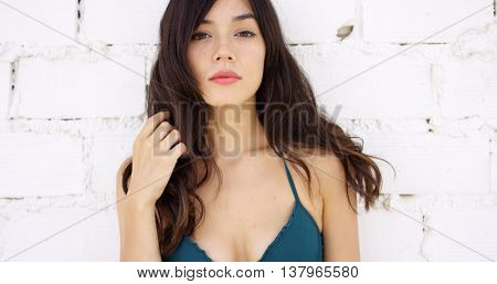 Seductive young woman with a sultry expression