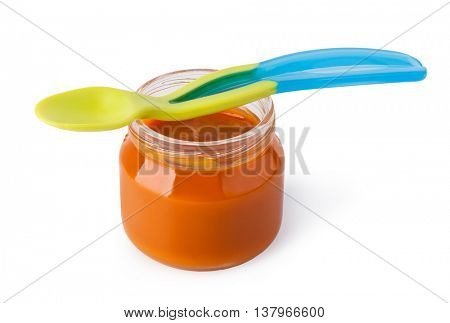 baby puree with spoon isolated on white background