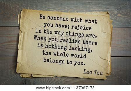 Ancient chinese philosopher Lao Tzu quote on old paper background.  Be content with what you have; rejoice in the way things are. When you realize there is nothing lacking, whole world belongs to you.