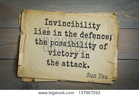 Ancient chinese strategist and philosopher Sun Tzu quote on old paper background. Invincibility lies in the defence; the possibility of victory in the attack.