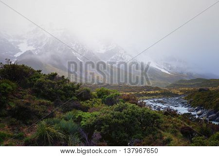 Thick fog covering the snow capped mountain.
