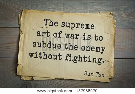 Ancient chinese strategist and philosopher Sun Tzu quote on old paper background. The supreme art of war is to subdue the enemy without fighting.