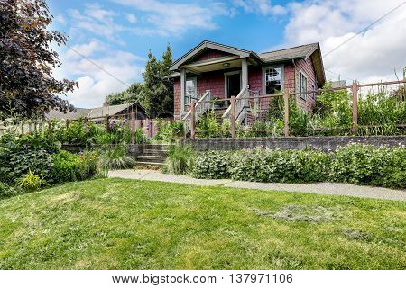 Big Farmhouse With Beautiful Flowerbed, Concrete Walkway