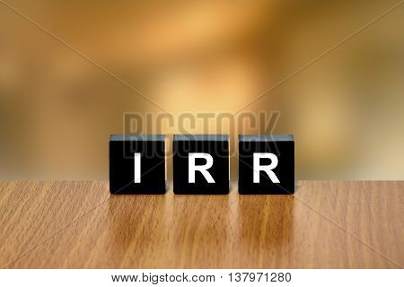 IRR or Internal Rate Of Return on black block with blurred background