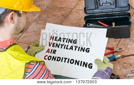 Repairman Is Looking At Documentation Of Hvac (heating, Ventilat