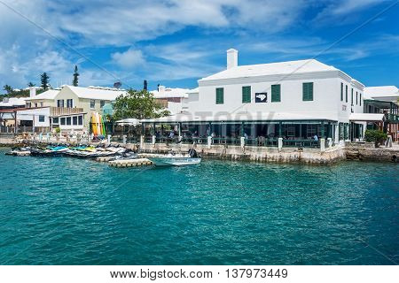 ST.GEORGE'S BERMUDA MAY 27 - Turquoise colored water surrounds this restaurant with outdoor dining on May 27 2016 in St. George's Bermuda.