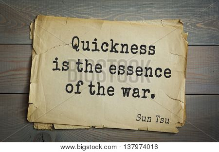 Ancient chinese strategist and philosopher Sun Tzu quote on old paper background. Quickness is the essence of the war.
