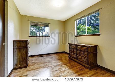 Empty Room With Hardwood Floor And Wooden Furniture